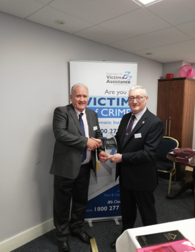 Michael O'Connor makes a presentation to Tom Brophy