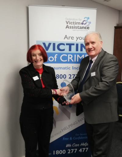 Tom Brophy makes presentation to Annette Hamill